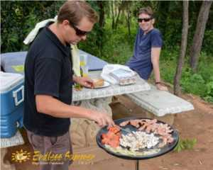 Guide cooks a breakfast on safari in Africa