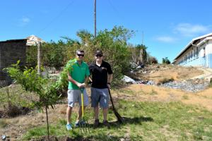Owners Anthony and Rhys pose next to a tree planted for arbor week